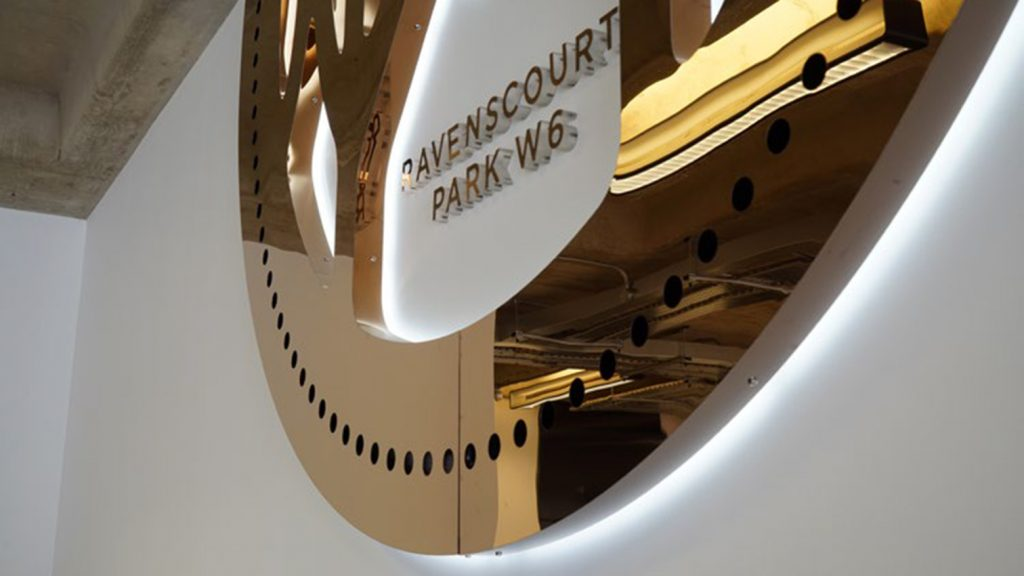 Clockwork Building, Copper clock over reception